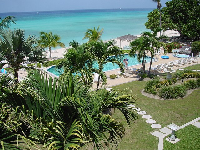 A 21-unit oceanfront condo hotel directly on Seven Mile Beach Grand Cayman