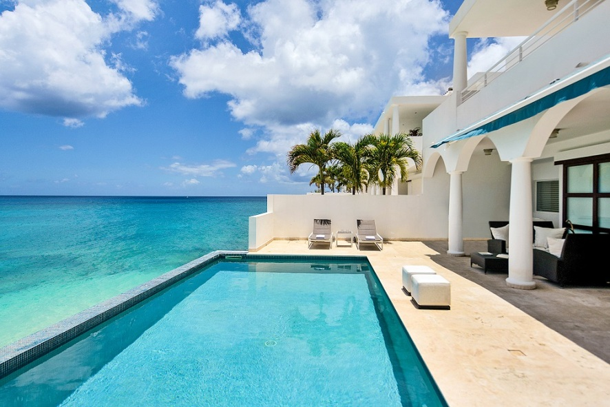 Beachfront luxury villa vacation rentals private pool shore pointe for Luxury holiday rentals ireland swimming pool